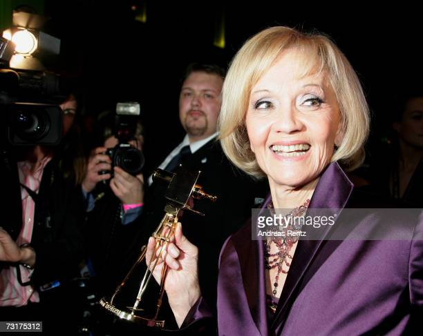 Liselotte Pulver poses with the award at the after show party at the 42nd Goldene Kamera Award at the UllsteinArena on February 1 2007 in Berlin...
