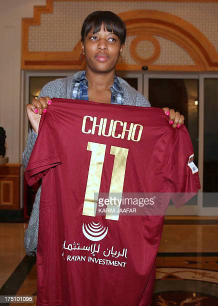 Liseth Chala the wife of Ecuadorian striker Christian 'Chucho' Benitez holds her husband's strip as she waits to escort her husbands body back to...