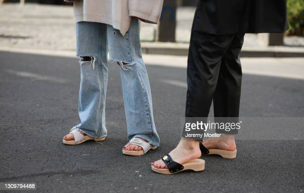 Lisi Rozay wearing black Zara pants and Scholl Iconic sandals and Henny Schäfer wearing Levis blue jeans and Scholl Iconic sandals on March 25, 2021...
