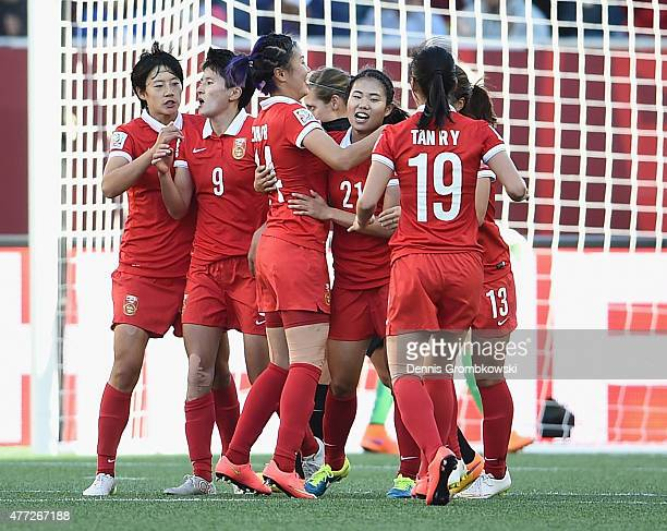 Lisi Wang of China PR celebrates with team mates as she scores their first goal from a penalty during the FIFA Women's World Cup Canada 2015 Group A...