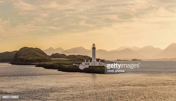 Lismore Lighthouse with dramatic sky at sunrise.