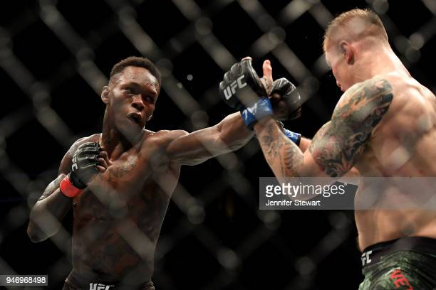 LIsrael Adesanya of Nigeria punches Marvin Vettori of Italy in their middleweight fight during the UFC Fight Night at Gila River Arena on April 14...