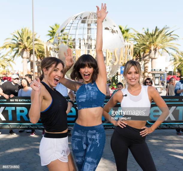 Lissa Bankston Nina Dobrev and Renee Bargh pose together at 'Extra' at Universal Studios Hollywood on December 15 2017 in Universal City California