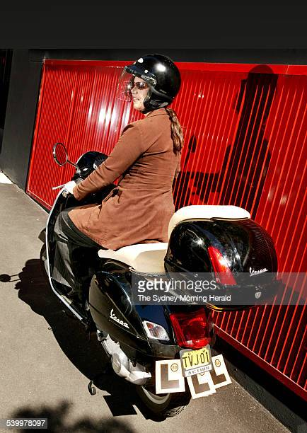 Lissa Christopher shows her Learner style on a black Vespa 7 April 2006 SMH Picture by QUENTIN JONES