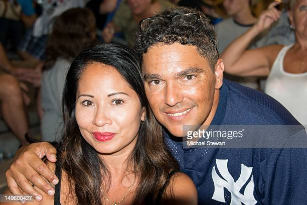 Lissa Espinosa and actor Nicholas Turturro attend the Baltimore Orioles Vs New York Yankees game at Yankee Stadium on July 31 2012 in the Bronx...