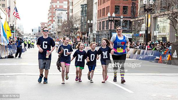 Lissie Minihane crosses the Boston Marathon finish line with her children from left Patrick Lucy Charlotte Sean and Sophie in Boston on April 18 2016