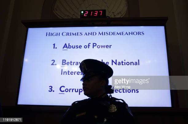 List of high crimes and misdemeanors are listed on a monitor as constitutional scholars Noah Feldman of Harvard University, Pamela Karlan of Stanford...
