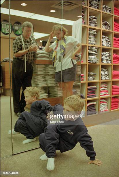 list of kids trying on their new schooluniformsBest pics are probably of a little blond boy 5 year old William Harris 5 with mom Kimberley and...