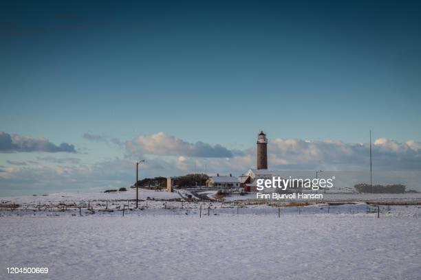 lista lighthouse norway - winter and snow - finn bjurvoll stock pictures, royalty-free photos & images