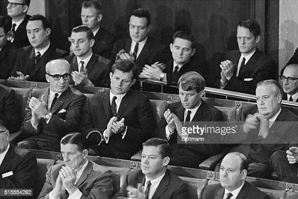 Listening intently as President Johnson addresses a joint session of Congress are left to right Attorney General Robert F Kennedy Interior Secretary...