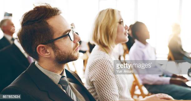 listening intently - audience stock photos and pictures