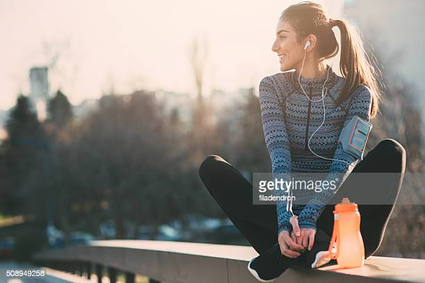 listening the music - sportswear stock pictures, royalty-free photos & images