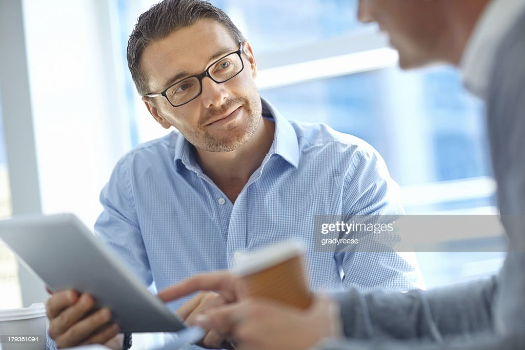 Listening to a colleague's corporate advice : Stock Photo