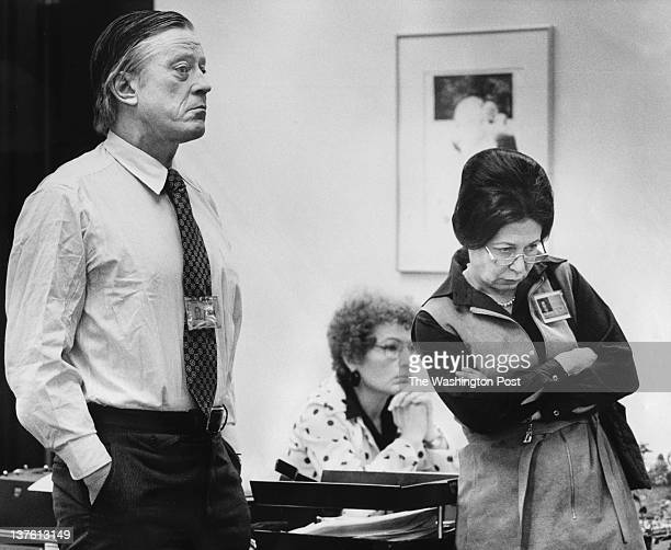 Listening to a statement being read by Katharine Graham on the situation with the striking Washington Post pressmen are Ben Bradlee executive...