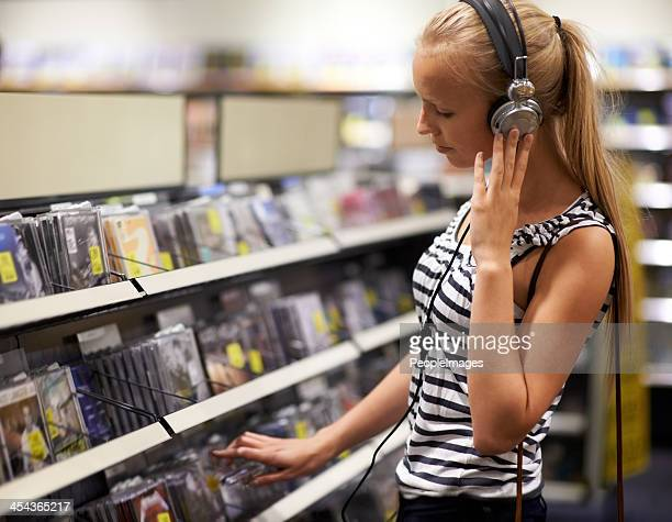 listening to her bands' new single - compact disc stock pictures, royalty-free photos & images