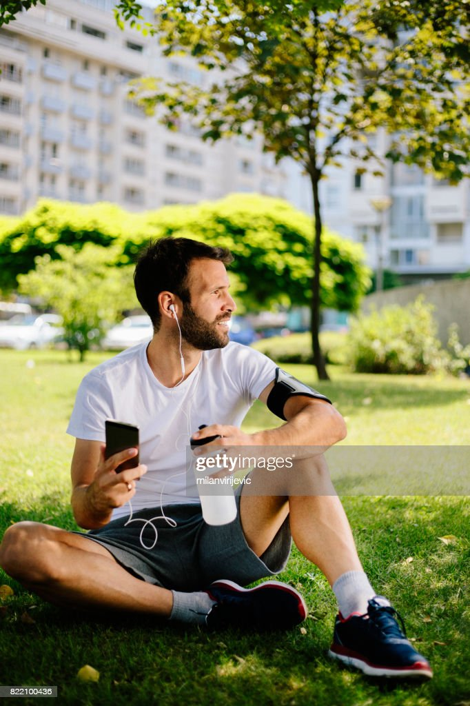Listening to music after training in nature : Stock Photo
