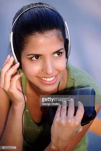 listening to music - personal compact disc player stock pictures, royalty-free photos & images