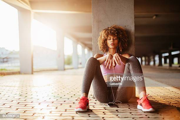 listening to music - womens track stock photos and pictures