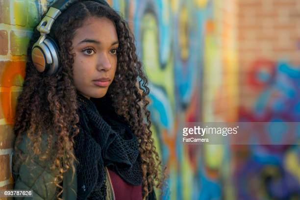 listening to music - beautiful black teen girl stock photos and pictures