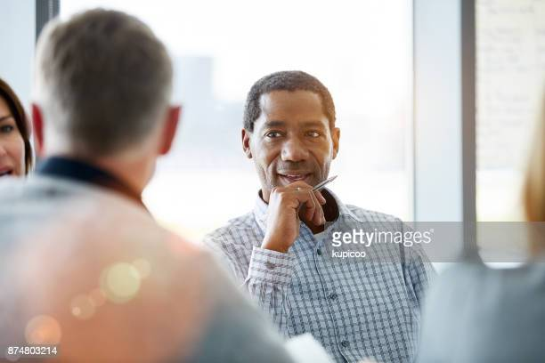 listening to some ideas in the boardroom - listening stock pictures, royalty-free photos & images