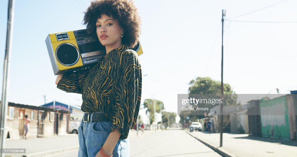 Listening to the sounds of the streets : Stock Photo
