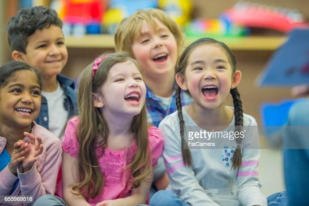 Listening to Their Teacher Read a Story