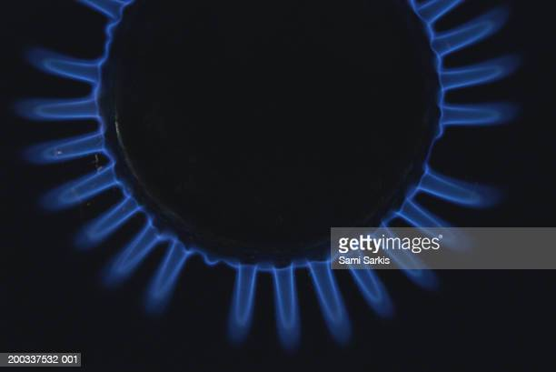Lit blue gas ring, close-up