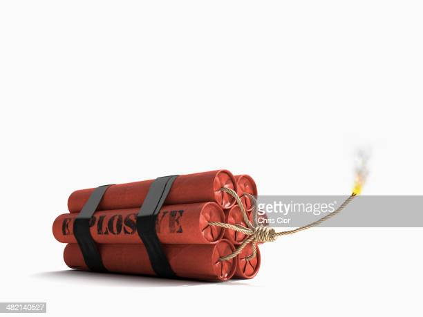lit bundle of dynamite - fuse stock photos and pictures