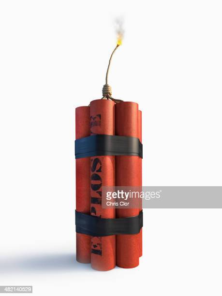 lit bundle of dynamite - explosives stock photos and pictures