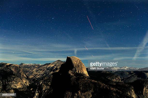 Lit by a very bright half moon night becomes day during this 30second time exposure view of the stars and aircraft in the skies over Half Dome at 935...