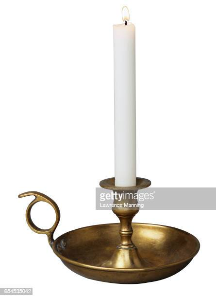 Lit Candle in Golden Candleholder