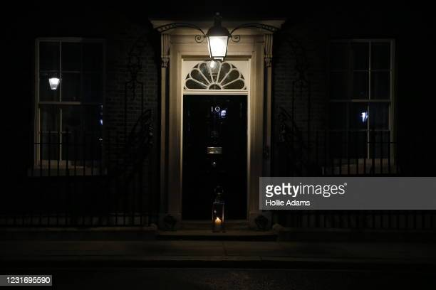 Lit candle is seen on the doorstep of 10 Downing Street on March 13, 2021 in London, United Kingdom. Vigils are being held across the United Kingdom...