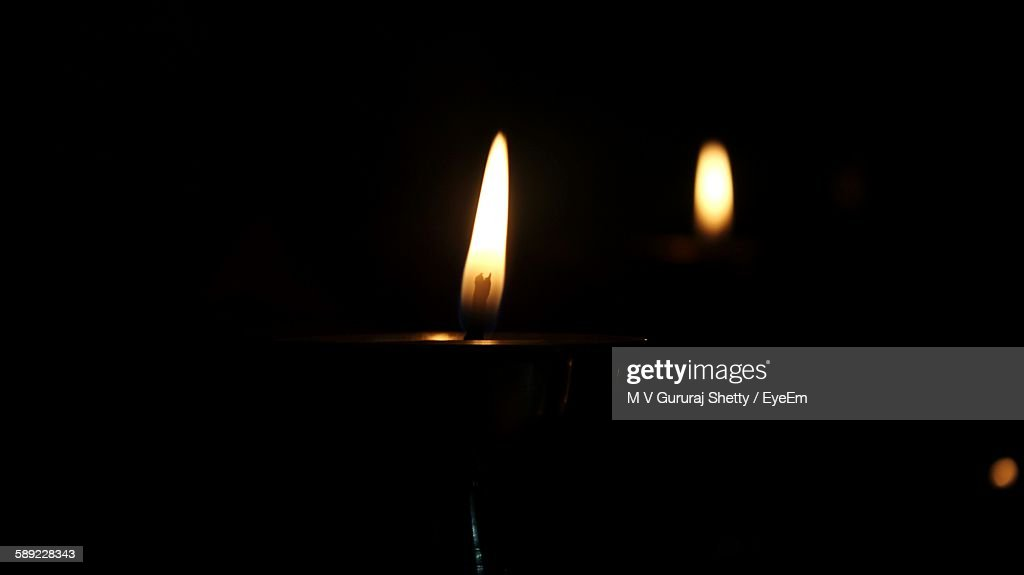 Lit Candles Against Black Background : Stock Photo