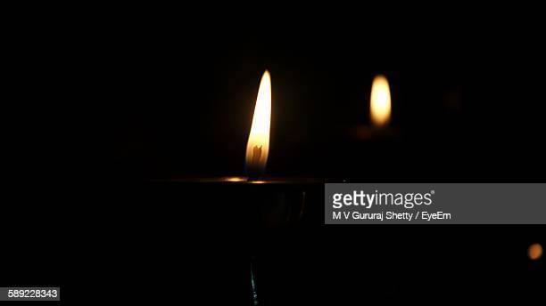 Lit Candles Against Black Background
