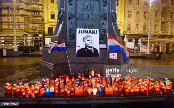 Lit candles and flags are placed in tribute to General Slobodan Praljak in Zagreb on November 30 after the Bosnian Croat war criminal took his own...
