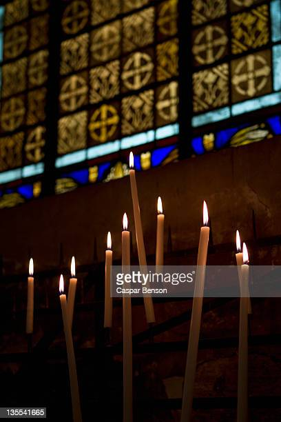 Lit candles in a church