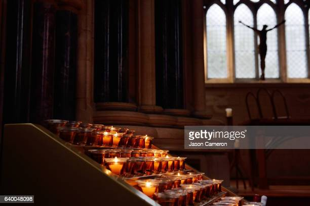 lit candles in a church - catholicism stock pictures, royalty-free photos & images
