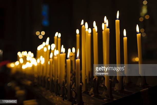 Lit Candles in Church Interior at Christmas