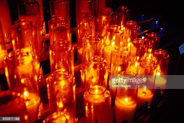 lit candles in church - faith rogers stock pictures, royalty-free photos & images