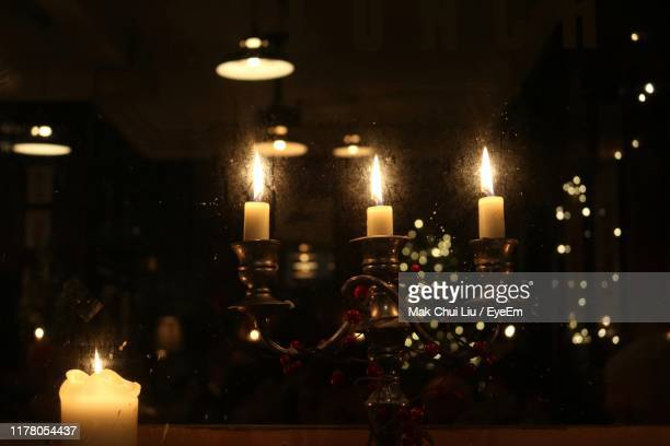 lit candles in darkroom - liu he stock pictures, royalty-free photos & images