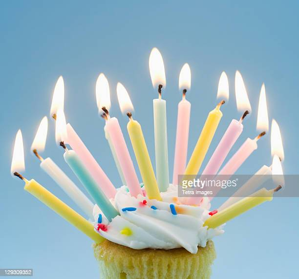 lit candles on cupcake - excess stock pictures, royalty-free photos & images