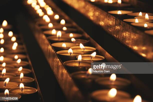 lit candles - death stock pictures, royalty-free photos & images