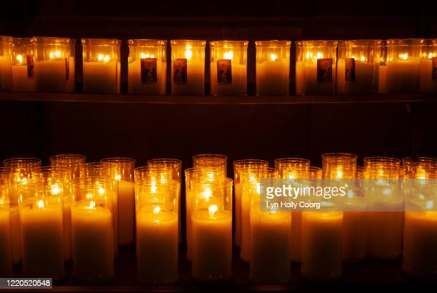 lit candles votive offerings in church - lyn holly coorg stock pictures, royalty-free photos & images