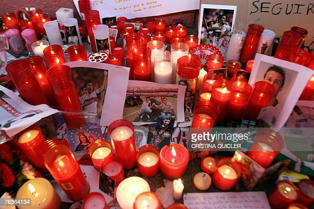 Lit candles with pictures of Sevilla's defender Antonio Puerta are seen at Sanchez Pizjuan Stadium 28 August 2007 after his death today at Seville's...