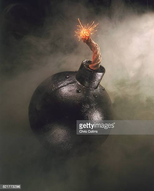 lit cannonball - fuse stock photos and pictures