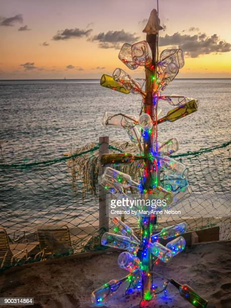 lit caribbean christmas tree made of bottles - caribbean christmas stock pictures, royalty-free photos & images