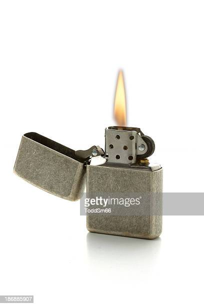 A lit cigarette lighter with the gray top folded open