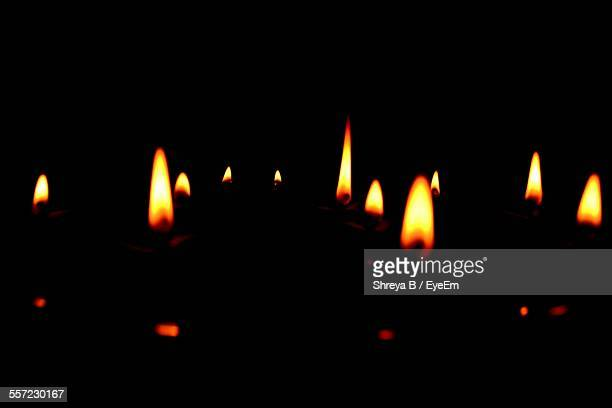 Lit Diwali Oil Lamps Against Black Background