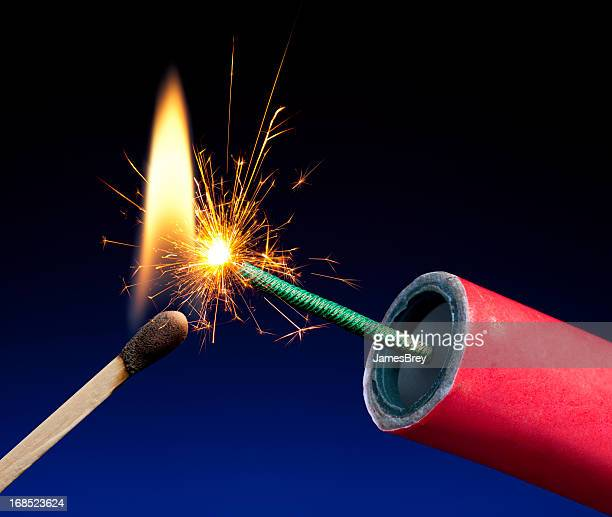 lit explosive fuse crackling and sparking - fuse stock photos and pictures