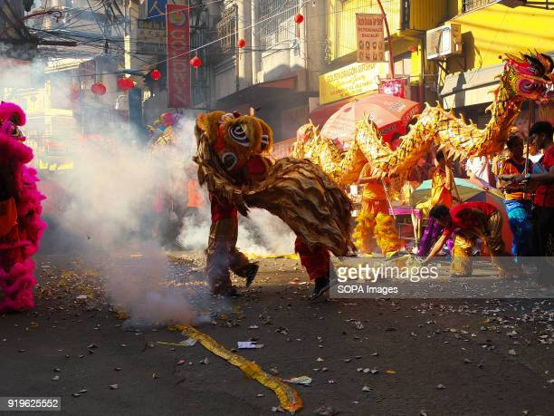 CHINATOWN MANILA PHILIPPINES Lit fireworks during the traditional dragon dance in the streets of chinatown in binondo Filipinos celebrated the...